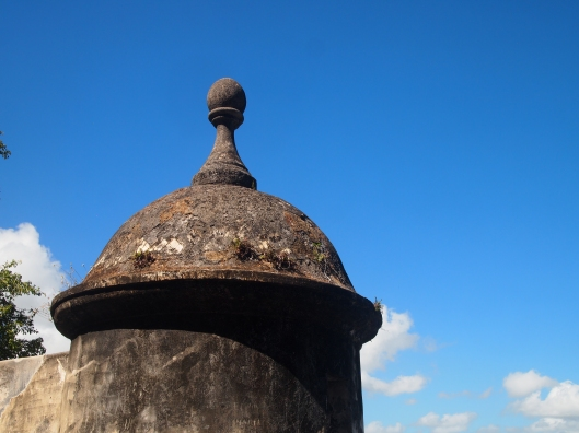 a turreted guard tower, called a garita,  with its distinctive conical structure