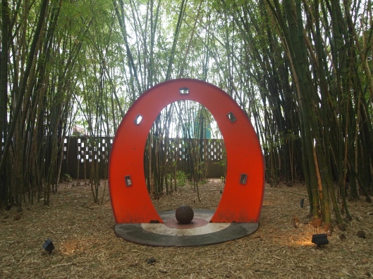 a sculpture in a bamboo grove