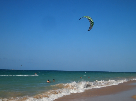 kiteboarders at the beach